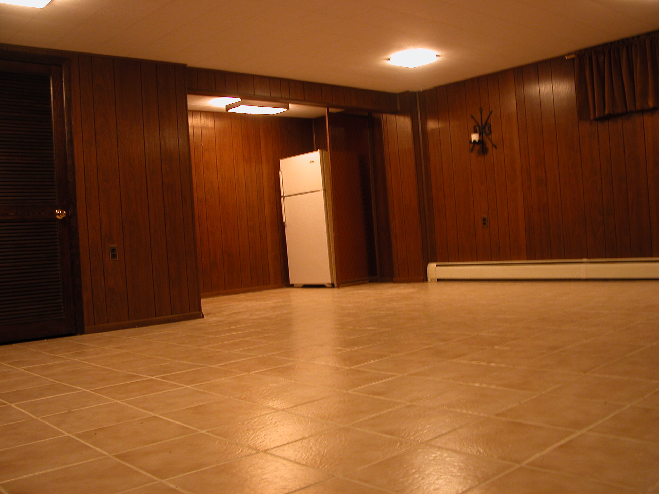 finished basement with ceramic tile floor and lots of storage